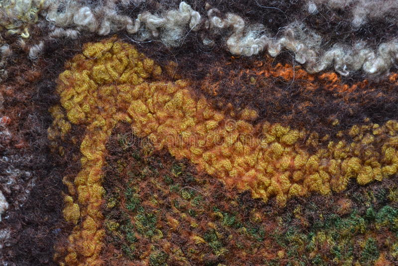 Fibras coloreadas de las lanas enmarañadas en una fibra mullida suave foto de archivo libre de regalías