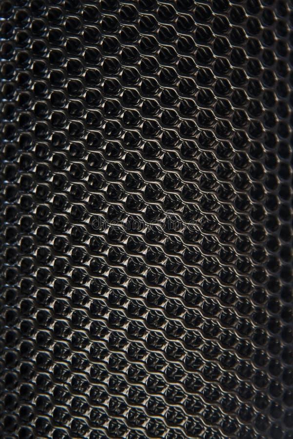 Fibre de carbone et fond gris-foncé images stock