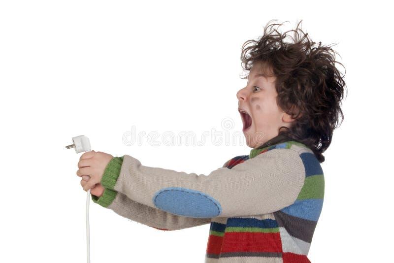 Fiche d'enfant recevant la décharge électrique photos stock