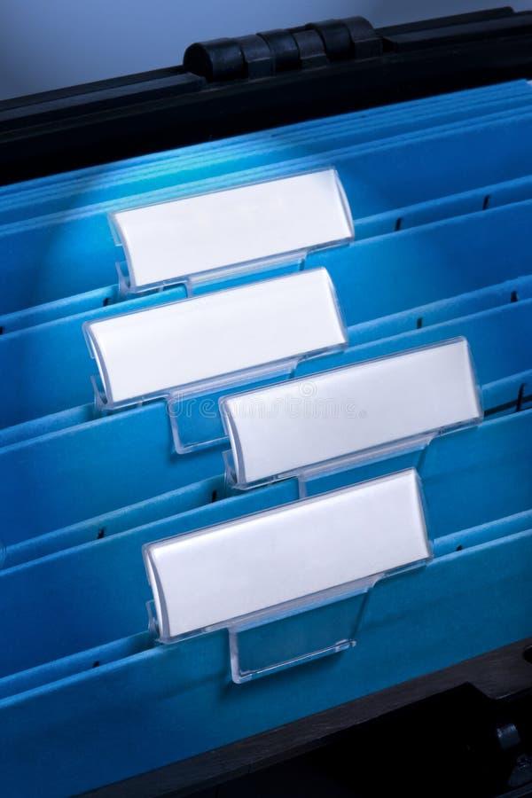Ficheros en blanco en cabinete de archivo fotografía de archivo