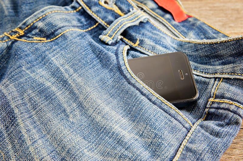 Fick- jeans för telefon royaltyfri bild