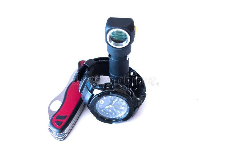 Ficklampa, klocka och kniv arkivfoton