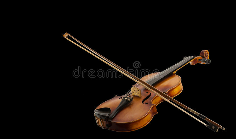 Fiddle and Bow. A Still life with a leaning fiddle with a bow on, isolated royalty free stock images