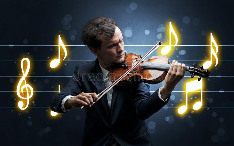 Fiddler joven con la hoja de m?sica imagenes de archivo