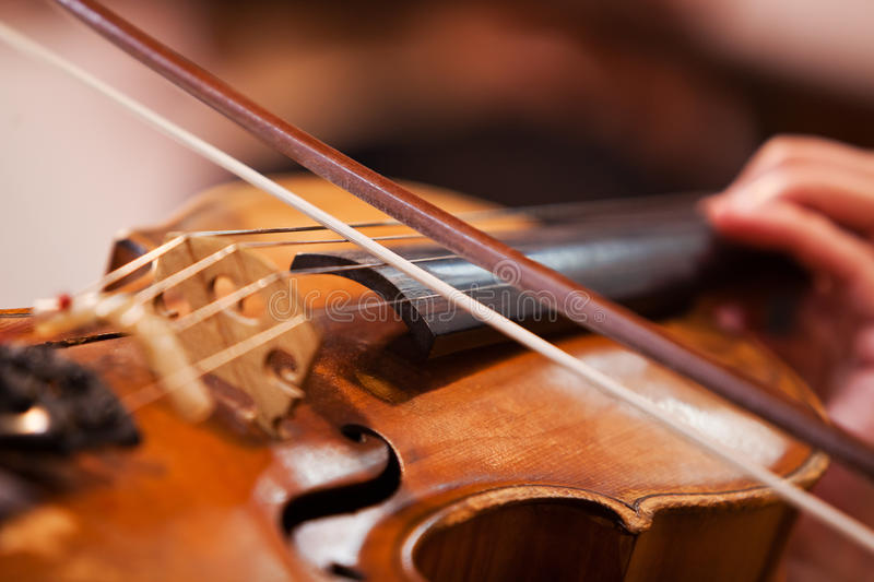 Fiddlestick on the strings of a violin. Closeup stock image