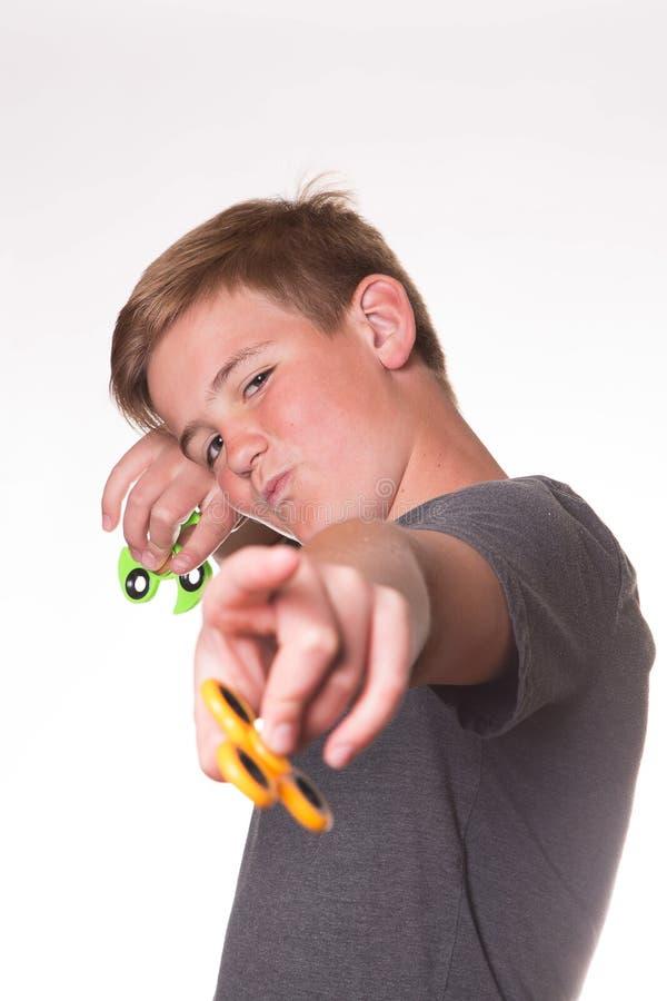Fidget εκμετάλλευσης αγοριών κλώστης στοκ φωτογραφία με δικαίωμα ελεύθερης χρήσης