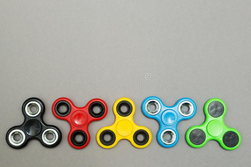 Fidget finger spinner stress, anxiety relief toy, space for text.  royalty free stock image