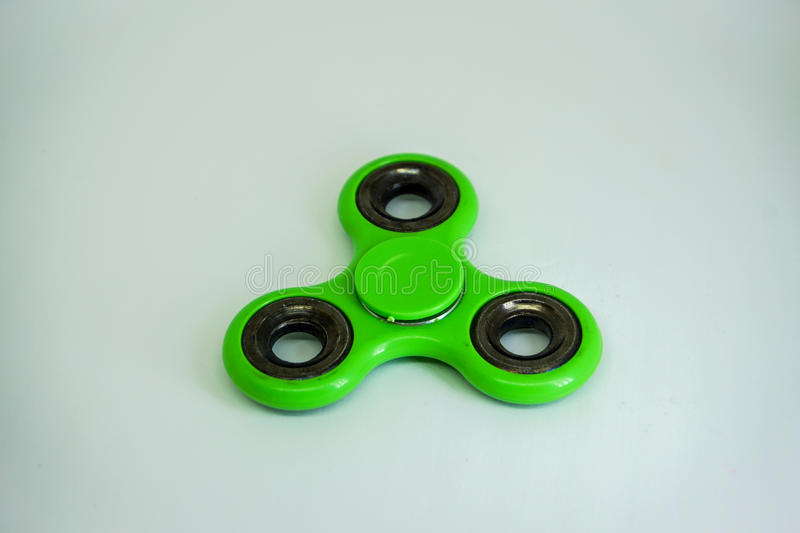 Fidget finger spinner stress, anxiety relief toy royalty free stock images