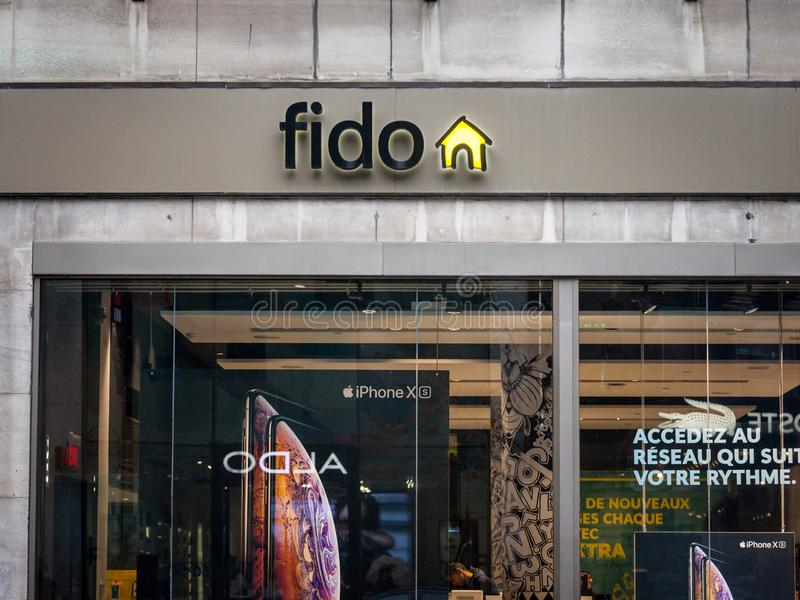 Fido logo in front of their local boutique in Montreal. Telus is a Canadian telecommunications company. MONTREAL, CANADA - NOVEMBER 5, 2018: ..Picture of a sign stock photo