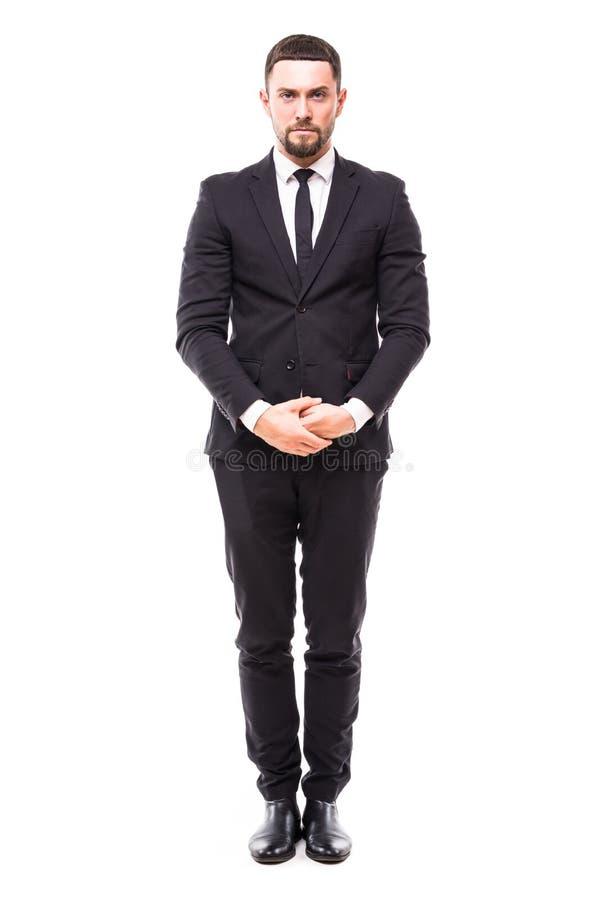 Fiducia e carisma Integrale di giovane uomo barbuto sorridente in formalwear che tiene le mani attraversate e che esamina i again fotografia stock libera da diritti