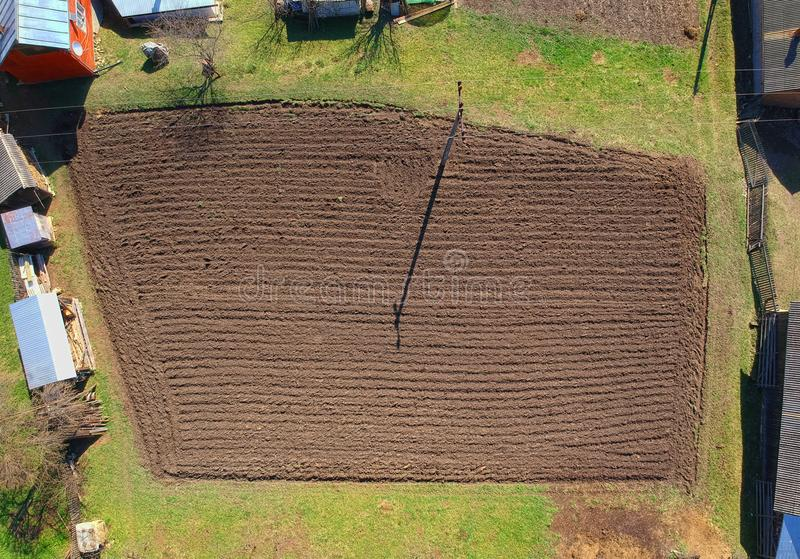 Field for agriculture in the village. Aerial view stock image