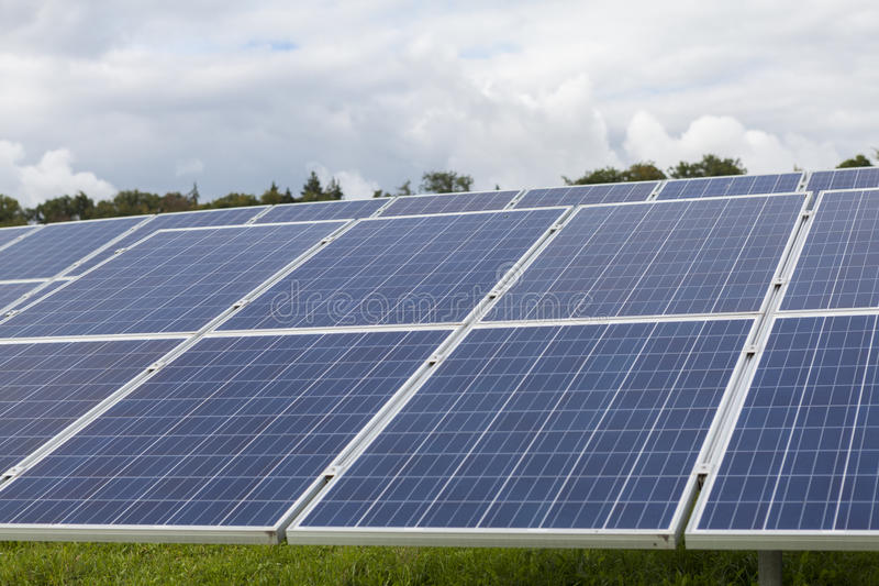 Field with blue silicon solar cells alternative energy. To collect sun energy royalty free stock photography