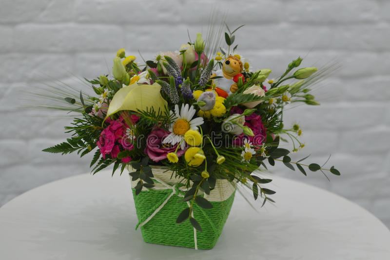 Field bouquet of wild flowers in a box stock photography