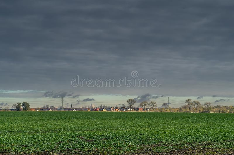 Field in the countryside under steel sky. royalty free stock photography