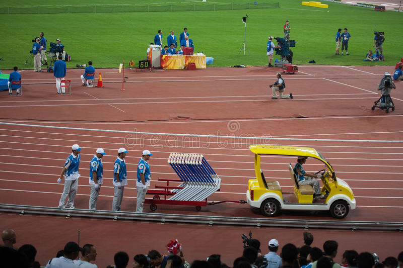 Download Field Crew Sets Up Hurdles For Track And Field Eve Editorial Stock Image - Image: 25676954