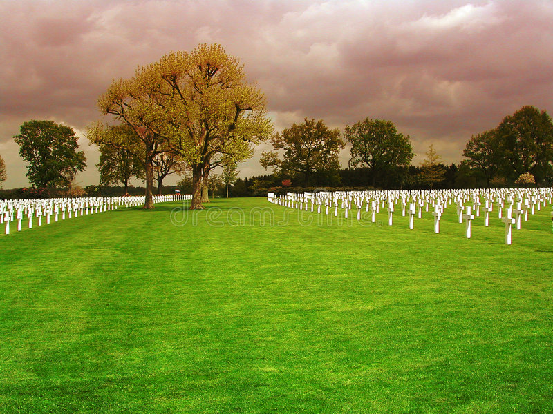 Field with crosses on the Netherlands American Cemetery in Margraten. A field with trees and white crosses on the Netherlands American Cemetery in Margraten royalty free stock photo