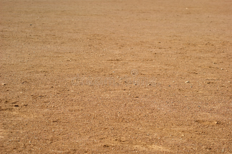 Field of Dirt. View of a field of dirt at a baseball diamond stock photo