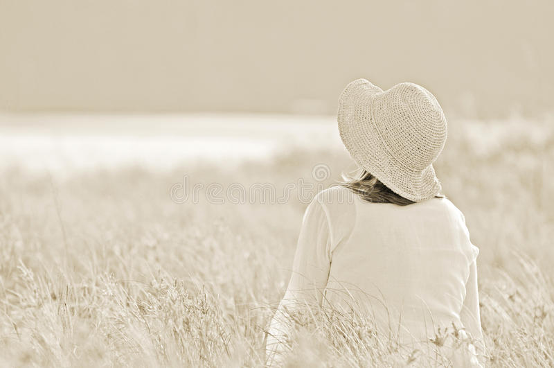 Field of dreams. Woman in meadow royalty free stock photo