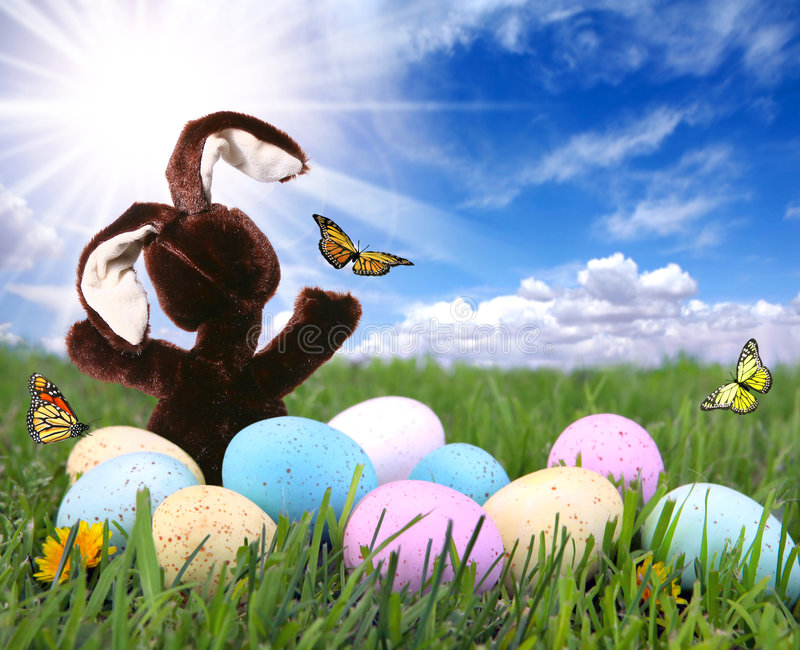 Field With Easter Bunny Rabbit Eggs and Butterflie
