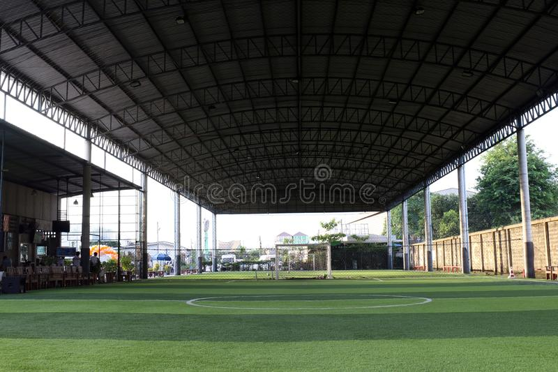 Football field Small, Futsal ball field in the gym indoor, Soccer sport field outdoor park with artificial turf royalty free stock photos