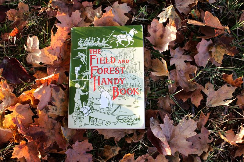 The Field and Forest Handy Books on Autumn leaves and grass. Phil Campbell, Alabama, United States, September 9, 2019 The Field and Forest Handy Books on Autumn royalty free stock images