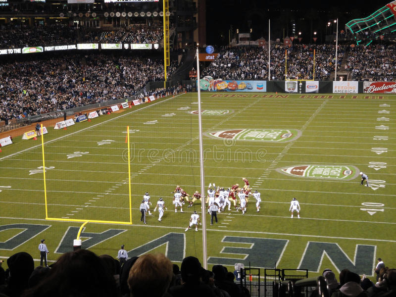 Field Goal attempt in action. SAN FRANCISCO - JANUARY 9: Fight Hunger Bowl - UNR vs. BC: Field Goal attempt in action with BC kicking ATT Park in San Francisco royalty free stock image