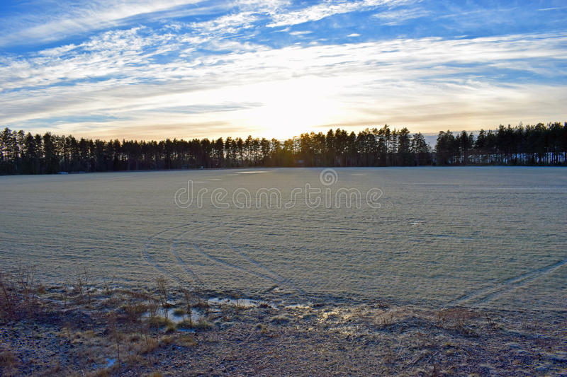 Field with hoarfrost and beautiful sky. Frozen field on countryside, Finland royalty free stock photo