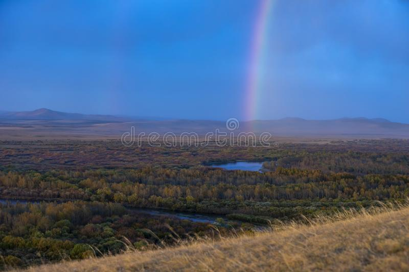 FIELD AT HULUNBEIR CHINA RAINBOW AUTUMN royalty free stock images
