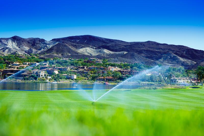Field and irrigation on the city background. stock photography