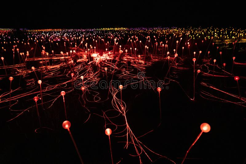 Field of light Uluru at night a light-based artistic installation created by British artist Bruce Munro with mostly red lights stock photo