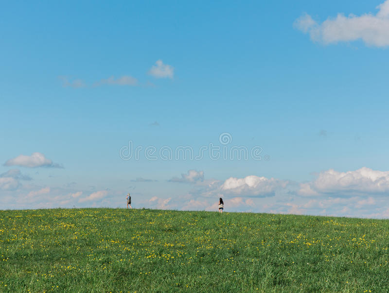 Field with people running through stock photos
