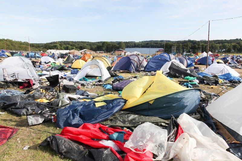 Field and tent village after the rock festival `Smukfest` in Skanderborg, Denmark. Skanderborg, Denmark - August 14, 2017: Field and tent village after the rock stock images