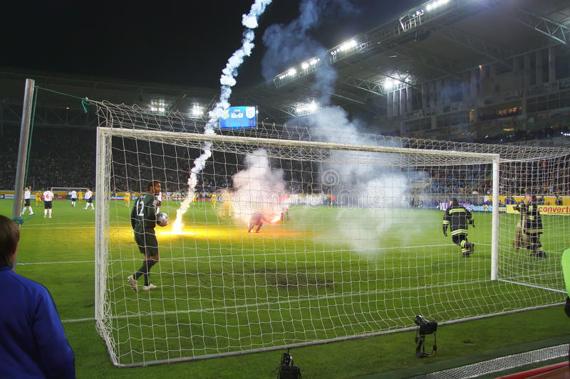 On the field throwing Fire. Dnepropetrovsk - October 10: Stadium Dnipro Arena game playoff qualification of World Cup 2010 between teams of the national teams of stock photo