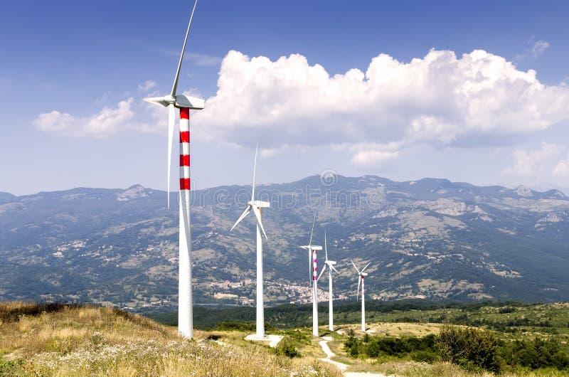 field turbines wind yellow royaltyfri bild