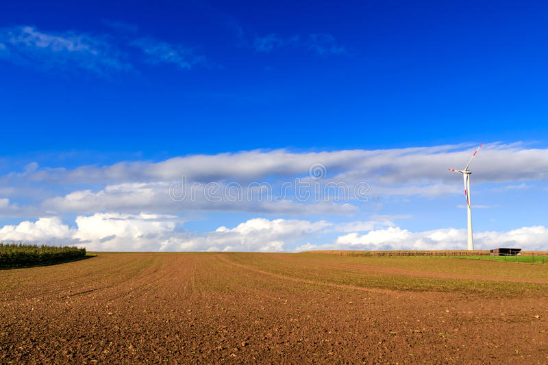 Field with wind turbine stock photos