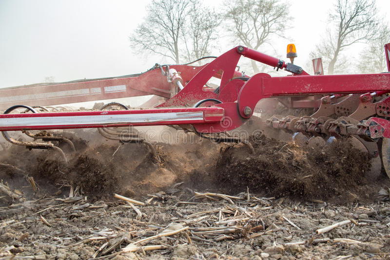 Field works. The harvester plowing and collecting on the field royalty free stock photo