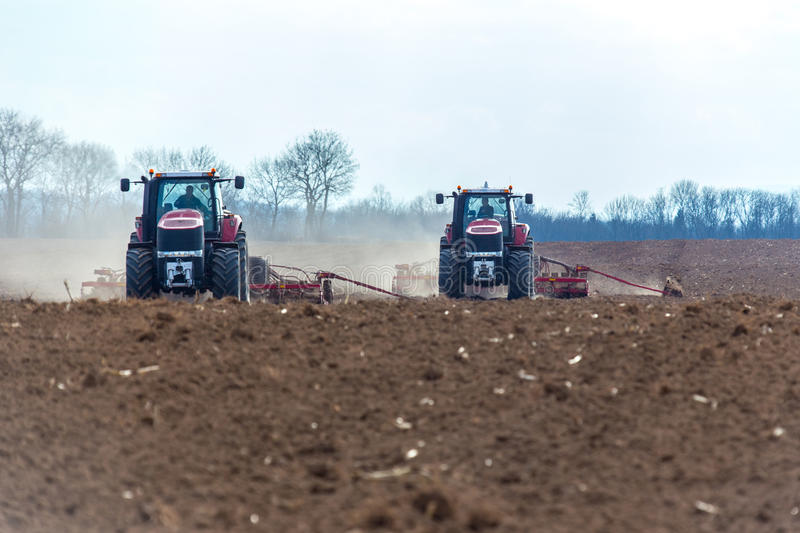 Field works. The tractor working on the large field royalty free stock photography