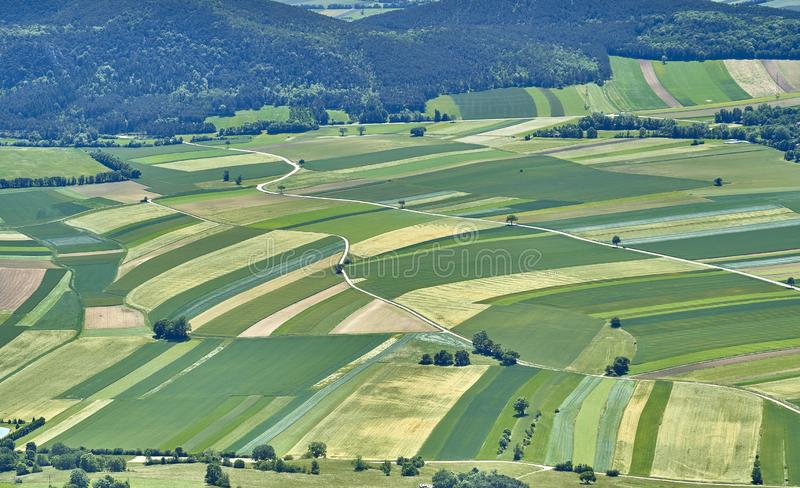 Fields, forest and roads building nice patterns. Hohe Wand, Austria. stock photos