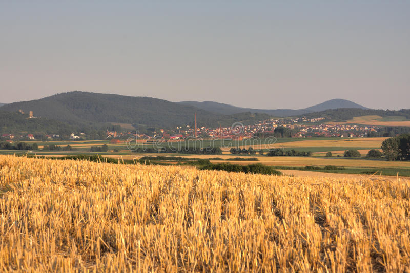 Fields and forestst. In german landscape, volkmarsen in the background royalty free stock photography