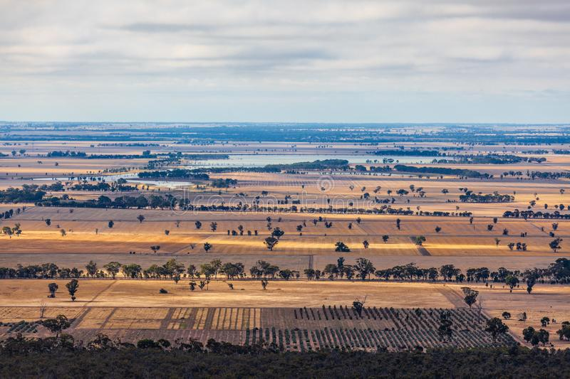 Fields and lake in Australian countryside. stock photos