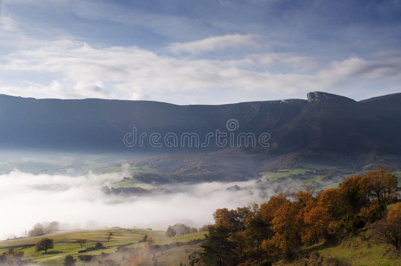 Download Fields And Mountains On A Cold Morning, Fog In The Valley And Clouds In The Sky Stock Image - Image: 28676129