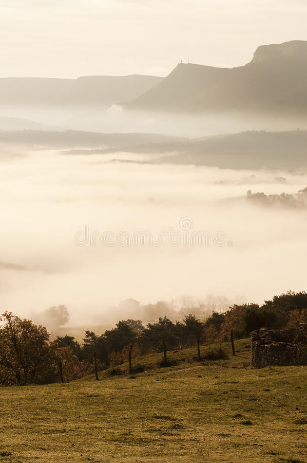 Download Fields And Mountains On A Cold Morning, Fog In The Valley And Clouds In The Sky Stock Photo - Image: 29030164