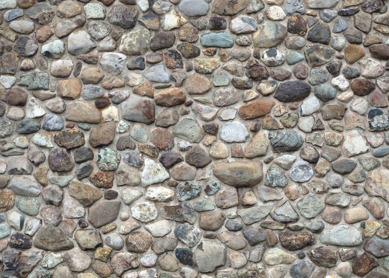 Fieldstone van de steenmuur en concrete natuurlijke de bouwtextuur stock afbeelding
