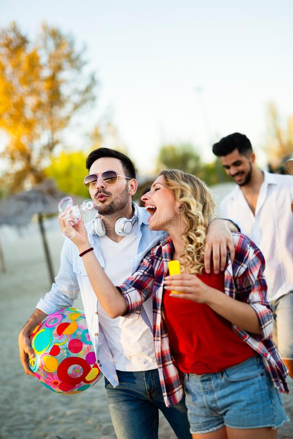 Fiends having a great time at the beach stock photography