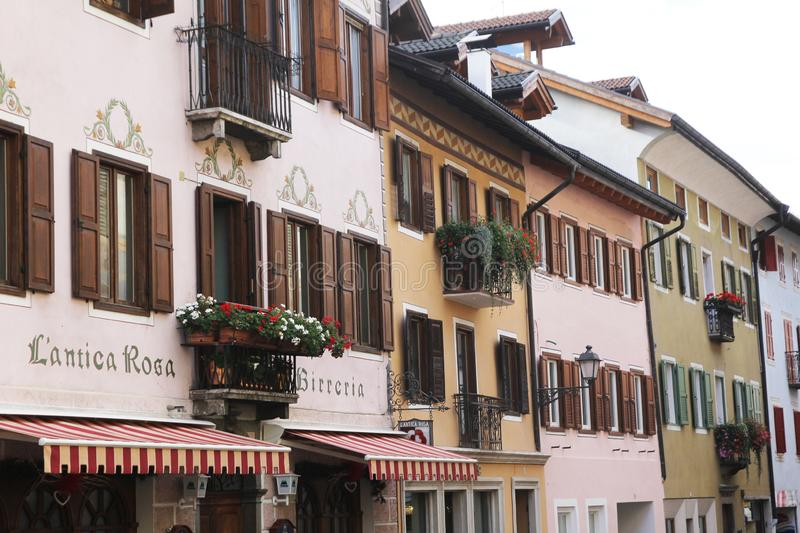 Fiera buildings. Old buildings at fiera di primiero in italy stock photography