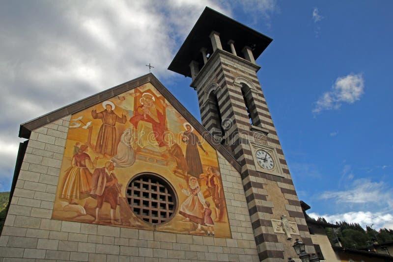 The fiera church. The historic main church at fiera di primiero in italy stock photos