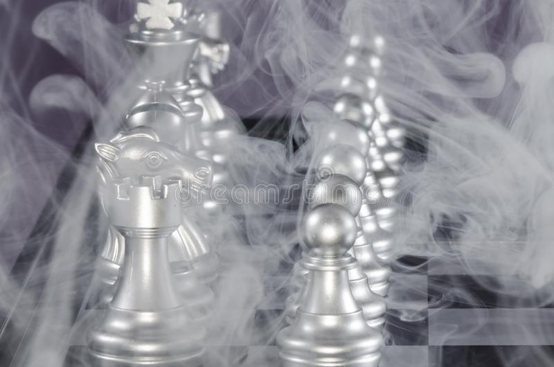 Fierce Chess Battle and the Fog of War. Fierce Chess Battle and the Relentless Fog of War royalty free stock photography
