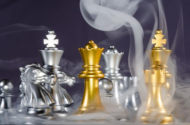 Fierce Chess Battle and the Fog of War. Fierce Chess Battle and the Relentless Fog of War royalty free stock image