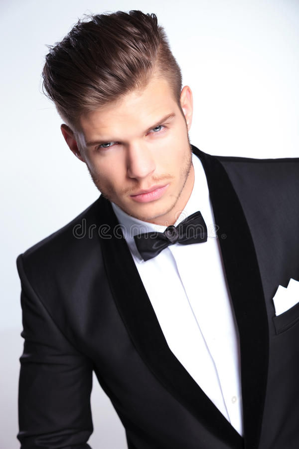 Fierce fashion business man looking at you royalty free stock photo