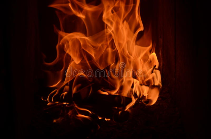 Fire flames in the fireplace royalty free stock photos